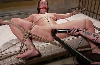 Redheads pussy controlled by master whille tied to the bed.  xxx porn