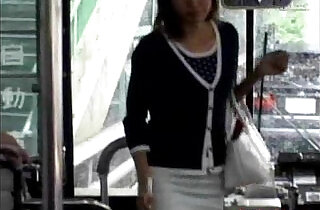 A young Asian girl enters a public bus and sits down from.  xxx porn