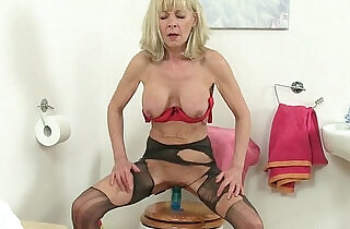 British grannies Elaine and Amanda fuck a dildo on toilet.  xxx porn