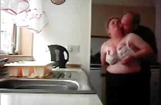 Mum and dad home alones having fun in the kitchen. Hidden cam.  xxx porn