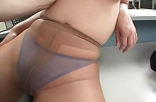 Lady in pantyhose is pleasured as man licks her tits.  xxx porn