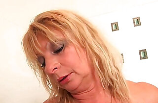 Big breasted granny gives her pussy a treat in the shower.  xxx porn
