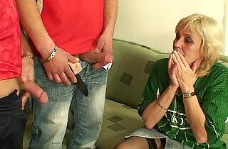 Granny football fan swallows two cocks.  xxx porn