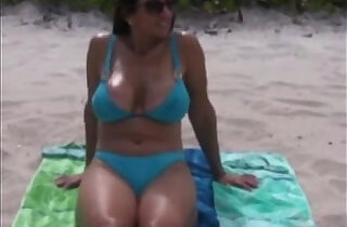 Milf exposed at the beach.  xxx porn