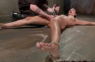Tied up hanging brunette spanked by her master.  xxx porn