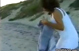 son having fun with his sister and mother on the beach.  xxx porn